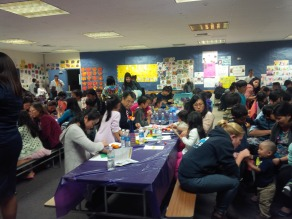 Families at Doyle PEN working together on an art activity